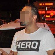 Giydiği 'HERO' yazılı tişörtü yakmak istedi